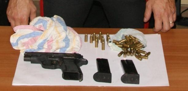 14868-1-pistola-e-munizioni